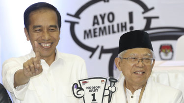Indonesian President Joko Widodo (left) with his running mate, conservative Muslim figure Ma'ruf Amin.