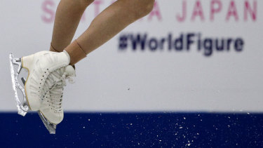 Bell captured performing a jump during the ladies short program in the ISU World Figure Skating Championships in Saitama on Wednesday.