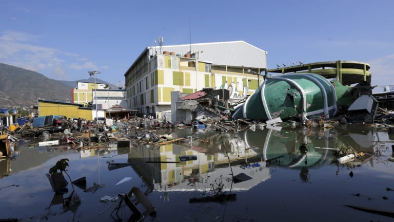 The damage to a shopping mall and mosque are visible following earthquakes and tsunami in Palu.