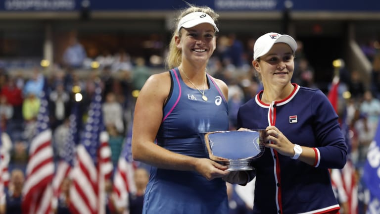 Barty (R) celebrates her maiden grand slam title earlier this year, the 2018 US Open women's doubles which she won with CoCo Vandeweghe.