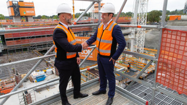 Geocon  managing director Nick Georgalis and Summer Housing chief executive Dan McLennan at the Republic building site in Belconnen where there will be 10  modified apartments for people with disabilities.