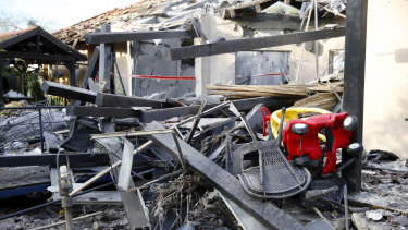 A house lies in ruins after being hit by a rocket in Mishmeret, central Israel, on Monday.