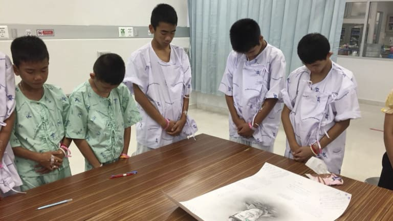 Some of the boys rescued from the Tham Luang cave pay their respects to former navy SEAL Saman Gunan.