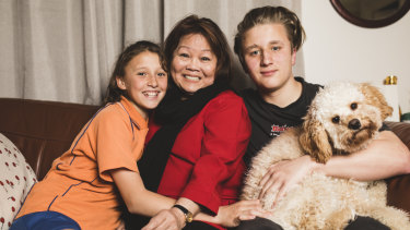 Mila Angcon with two of her grandchildren Rebecca, 12, and Riley, 15, and their dog Malakai.
