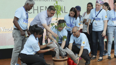 Malaysian Minister of Transport Anthony Loke, third from left, plants a tree at the Day of Remembrance event in Kuala Lumpur.