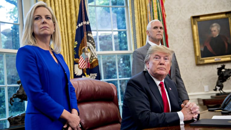 From left: US Secretary of Homeland Security Kirstjen Nielsen, President Donald Trump and Vice-President Mike Pence in the Oval Office after Trump signed the executive order.