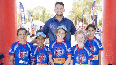 Canberra Raiders skipper Jarrod Croker, with kids (from left) Amy Herndezfino 9, Anisha Rao 9, Sophie Harris 9, Lili Hargraves 7, and Gaganpreet Kaur 9.