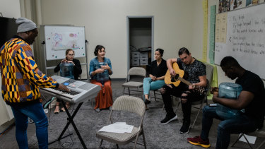 Interns and teachers play music in their down time at the International Rescue Committee in El Cajon.
