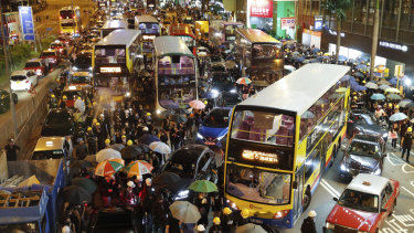 Protesters used barricades to block several roads at Causeway Bay in Hong Kong on Sunday night.