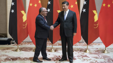 PNG leader Peter O'Neill meets Xi Jinping in Beijing on June 21. China is increasing its influence in PNG.