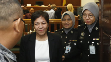 Australian Maria Elvira Pinto Exposto, second left, leaves her hearing at the Shah Alam High Court after being found not guilty last year.