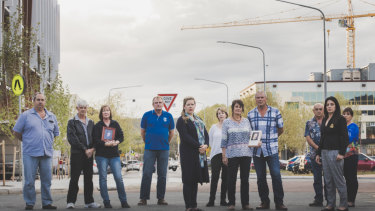 Families of those killed in industrial accidents gathered in Canberra in October ahead of the tabling of the report. Many are now unhappy with the government response. From left: Greg Zappelli, Mark and Janice Murrie, Michael Garrels,  (center) Dr. Lana Cormie, Shauna Branford, Robyn and Tony Hampton, Dave and Janine Brownlee, and Linda Moussa.