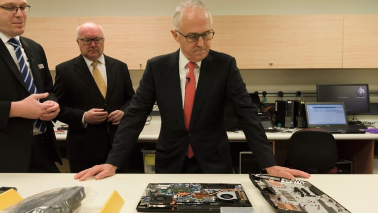 July 2017: Then prime minister Malcolm Turnbull and then attorney-general George Brandis at Australian Federal Police HQ in Sydney for a press conference on cyber security and encryption.