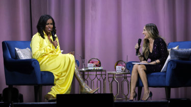 Former first lady Michelle Obama (left) wears the now famous Balenciaga boots for her interview with Sarah Jessica Parker about her book, 'Becoming'.