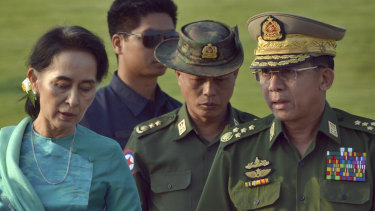 Aung San Suu Kyi, Myanmar's foreign minister and de facto leader, walks with General Min Aung Hlaing, Myanmar's commander-in-chief (right). The military has faced widespread accusations of genocide in its treatment of the country's Rohingya minority.