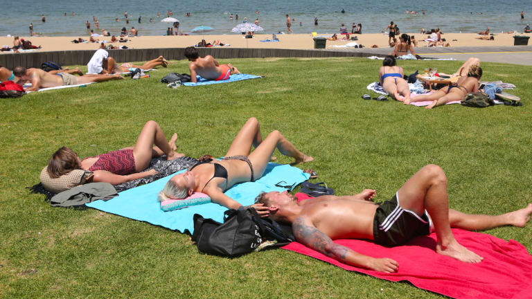 Beachgoers tried to find some relief at the St Kilda foreshore on Thursday.