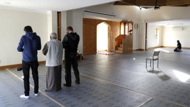 Muslim men pray in the refurbished Al Noor mosque in Christchurch, New Zealand.