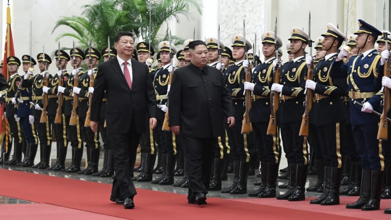 Chinese President Xi Jinping, left, and North Korean leader Kim Jong-un during a welcome ceremony at the Great Hall of the People in Beijing.