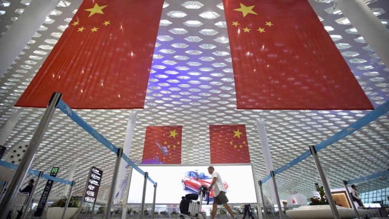Large Chinese flags hang in Shenzhen Baoan International Airport. China is marking the 40th anniversary of the Reform and Opening Up Policy, a program of economic liberalisation that led to the creation of special economic zones, such as the one in Shenzhen.