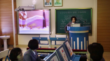 A computer generated video of North Korean flag is projected onto a screen during a multimedia class at Pyongyang Teachers' University.