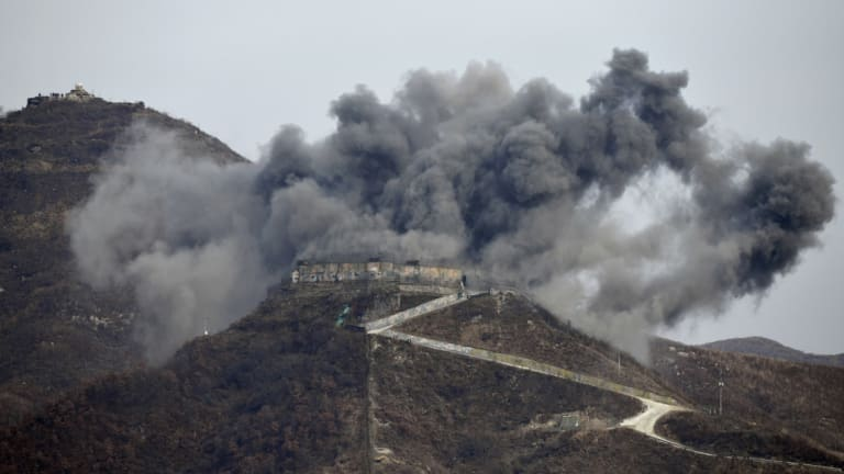 Smoke from an explosion rises last month as part of the dismantling of a South Korean guard post in the Demilitarized Zone dividing the two Koreas.