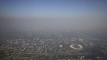Smog envelopes the horizon in Delhi.