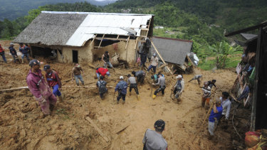 Rescuers search for victims at a village hit by the landslide.