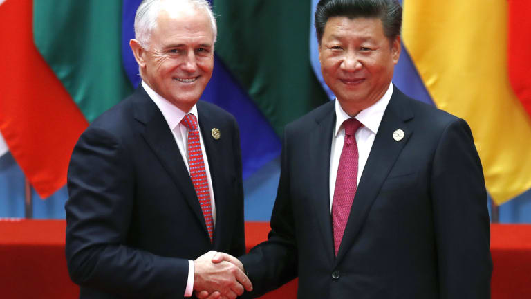 Prime Minister Malcolm Turnbull, left, shakes hands with China's President, Xi Jinping.
