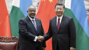 Chinese President Xi Jinping, right, shakes hands with Djibouti's President Ismail Omar Guelleh during a signing ceremony.