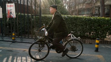 Han Zicheng, 85, rides his bicycle to a market in Tianjin, China, in January.