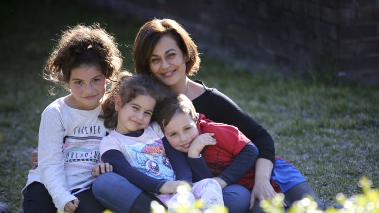 Theodora Hatzihrisafis at home with her three children, Petra, 9, Mina, 4 and Steven, 5.