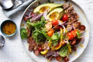 Steak and avocado salad with fried garlic vinaigrette.