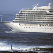 The Viking Sky lays at anchor in heavy seas.