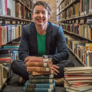 The Australian Common Reader project has identified the library borrowing habits of Australian readers at a selection of regional libraries between 1861 and 1928. The ANU School of Literature, Languages and Linguistics' Dr Julieanne Lamond (pictured) with sonme of the popular books.