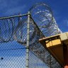 A barbed wire fence at Frank Baxter Juvenile Justice Centre in Kariong, NSW.