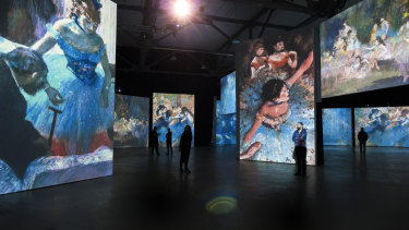 The exhibition combines projected images of artworks along with other sensory triggers.