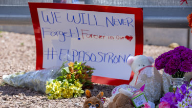 Flowers and toys adorn a makeshift memorial for the victims of the El Paso mass shooting in August.