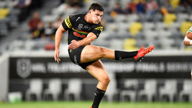 Nathan Cleary launches a clearing kick against South Sydney.