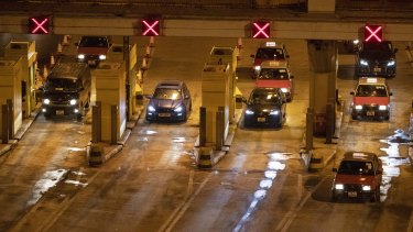 Vehicles move through the Cross-Harbour Tunnel, which has reopened, in Hong Kong.