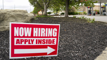 Hiring signs are posted outside a gas station in Cranberry township in Pennsylvania.  Such notices are springing up on streets and shopfronts all over the US.