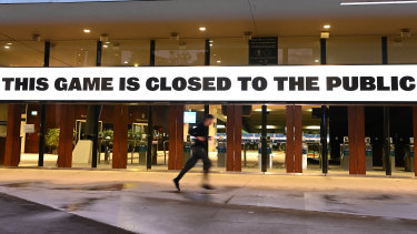A man runs past the MCG in July.