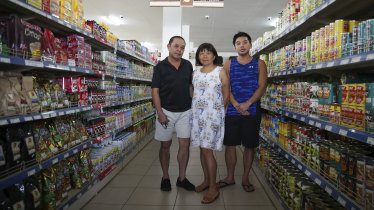 Business owners Richard and Rosemary Lo with their son Mathew Lo.