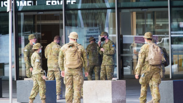 "ADF personnel prepare for  quarantine hotels at the Convention Centre, known as ""Jeff's Shed"", in South Wharf."