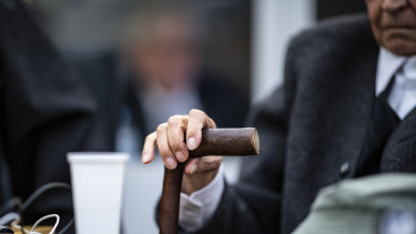 The 94-year-old former SS guard, whose face cannot be shown, holds his walking stick at the beginning of a trial in Germany.