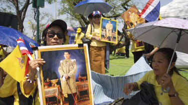 Well wishers with portraits of the new  King gather outside Bangkok's Grand Palace.