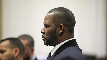 R. Kelly stands during a hearing in his sex abuse case at Leighton Criminal Court Building in May.