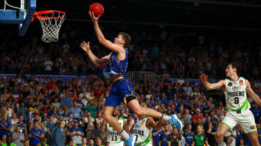 Up and away: Will Magnay flies to the basket for Brisbane against South East Melbourne.