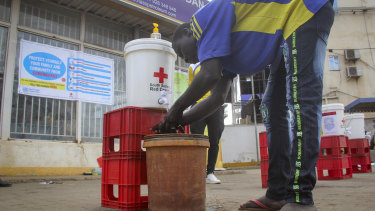 A man washes his hands to curb the spread of the new coronavirus in Juba, South Sudan.