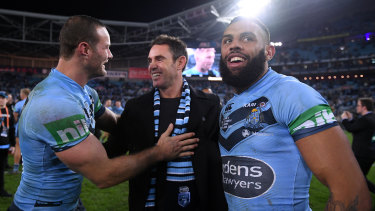 Winners are grinners: NSW coach Brad Fittler celebrates victory in Origin II in 2018 and the series with captain Boyd Cordner (left) and Josh Addo-Carr.
