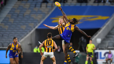Tap out: Eagle Nic Naitanui goes up against Hawthorn's Ben McEvoy in a ruck contest.